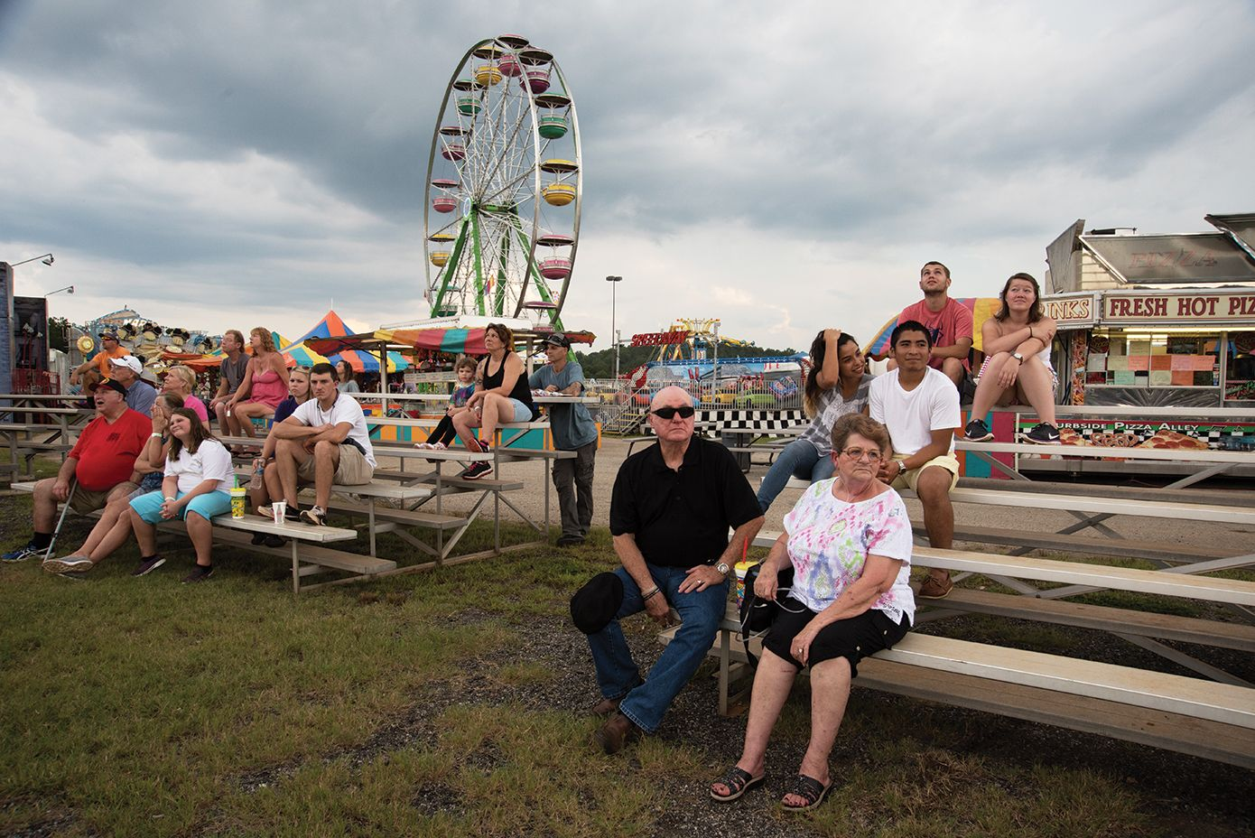 A family enjoys the Upper South Carolina State Fair at the NASCAR Greenville Pickens Speedway.