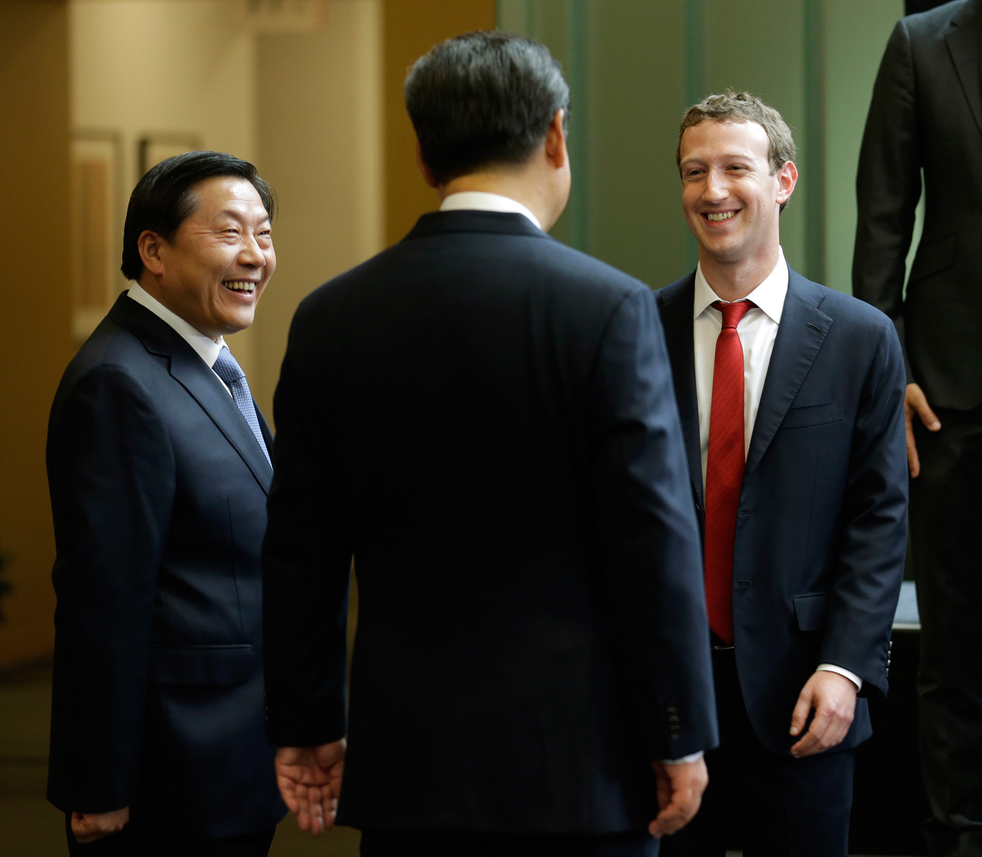 Lu Wei, China's Internet czar (left), speaks with Facebook CEO Mark Zuckerberg and Chinese president Xi Jinping at a meeting in 2015.
