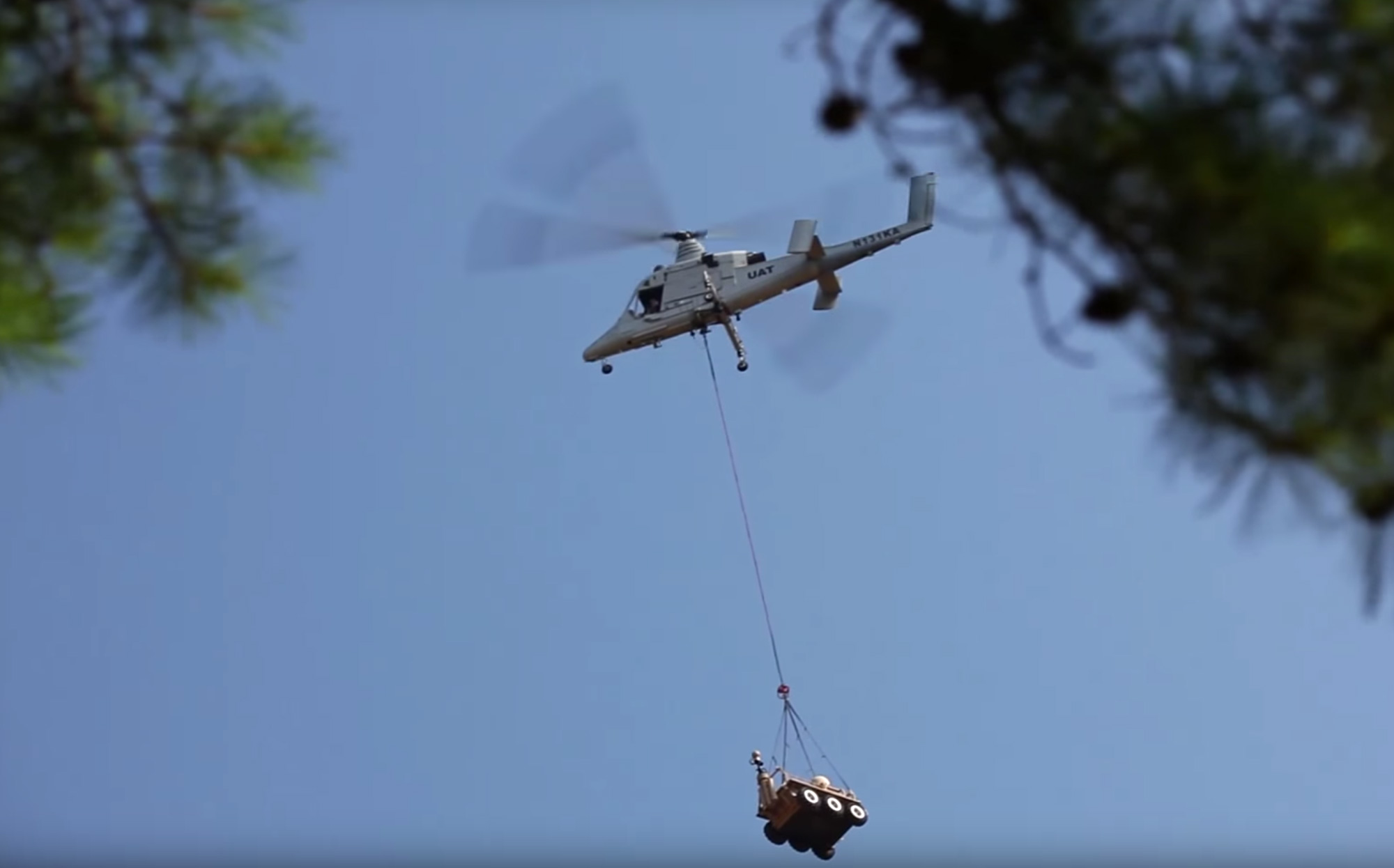 Lockheed Martin's autonomous K-MAX helicopter hauling a piece of gear.