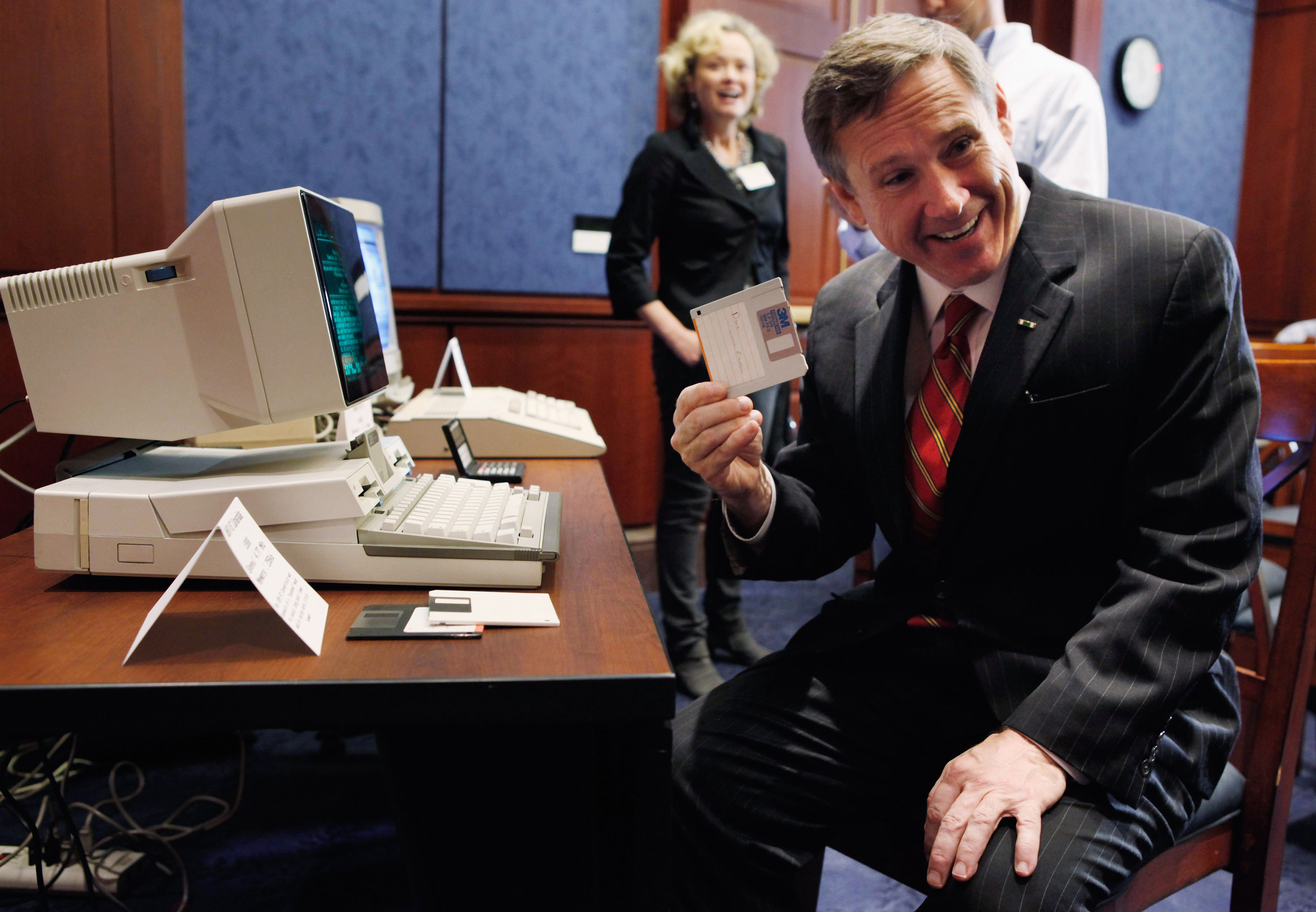 Lawmakers including former U.S. Senator Mark Kirk, seen here holding up a floppy disk in 2011, have been calling for reforms to the Electronic Communications Privacy Act for years.