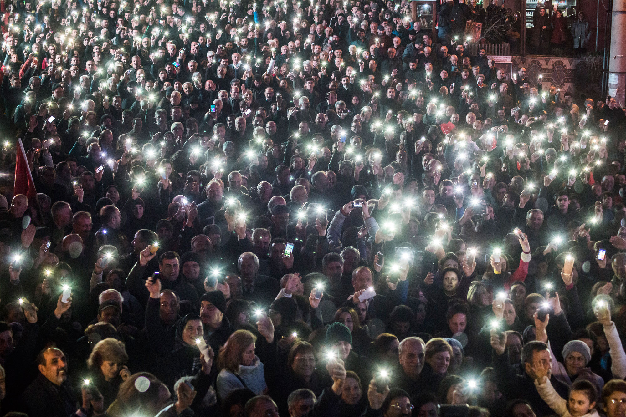 Protesters hold up their smartphones during a rally in Artvin, Turkey.