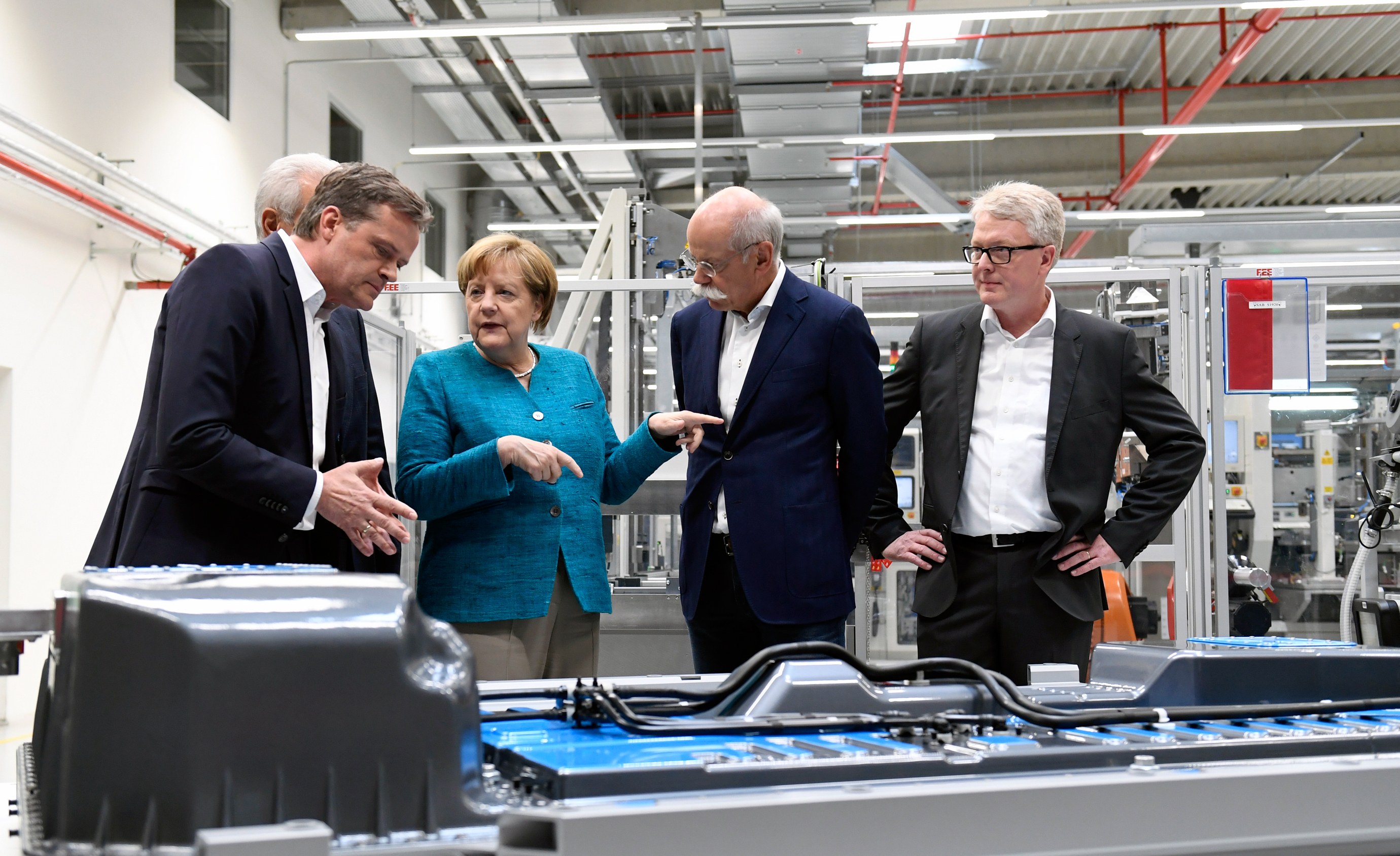 German chancellor Angela Merkel visits Accumotive's plant in Kamenz, Germany.